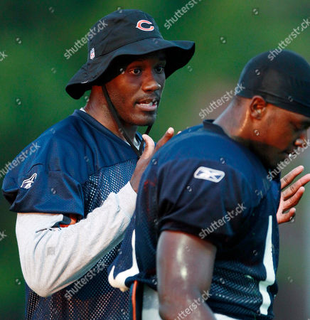 Roy Williams, Jimmy Young Chicago Bears wide receiver Roy Williams, left, talks to wide receiver Jimmy Young during NFL football training camp, at Olivet Nazarene University in Bourbonnais, Ill