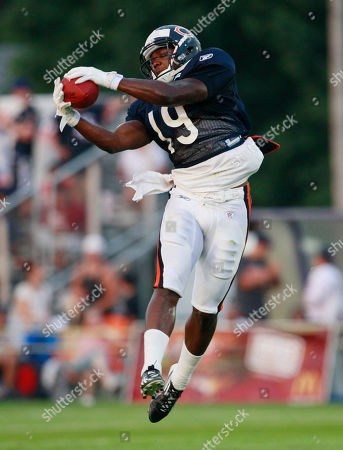 Jimmy Young Chicago Bears wide receiver Jimmy Young catches a ball during NFL football training camp, at Olivet Nazarene University in Bourbonnais, Ill