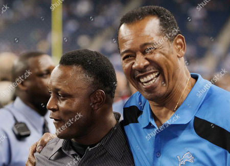 Charlie Sanders, Barry Sanders Detroit Lions assistant director of pro personnel Charlie Sanders, right, hugs former Detroit running back Barry Sanders before the Lions' NFL football game against the Chicago Bears in Detroit