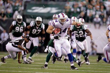 Scott Chandler, Donald Strickland Buffalo Bills tight end Scott Chandler (84) runs with the ball as New York Jets defensive back Donald Strickland tackles him during the fourth quarter of an NFL football game in East Rutherford, N.J. The Jets won the game 28-24