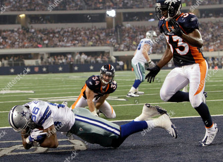 Raymond Radway, Nate Jones Dallas Cowboys wide receiver Raymond Radway, left, scores a touchdown from a six-yard pass by quarterback Stephen McGee as Denver Broncos cornerback Nate Jones. right, looks on in the third quarter of a preseason NFL football game, in Arlington, Texas