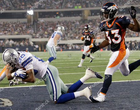 Raymond Radway, Nate Jones Dallas Cowboys wide receiver Raymond Radway scores a touchdown from a six-yard pass by quarterback Stephen McGee as Denver Broncos cornerback Nate Jones looks on in the third quarter of a preseason NFL football game, in Arlington, Texas
