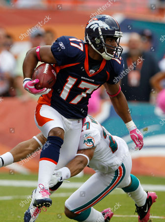 Jimmy Wilson, Quan Cosby Miami Dolphins defensive back Jimmy Wilson (27) attempts to tackle Denver Broncos wide receiver Quan Cosby (17), during an NFL football game, in Miami, Fla