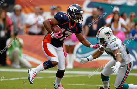 Quan Cosby, Jimmy Wilson, pink Denver Broncos wide receiver Quan Cosby (17) runs as Miami Dolphins defensive back Jimmy Wilson (27) defends during an NFL football game, in Miami