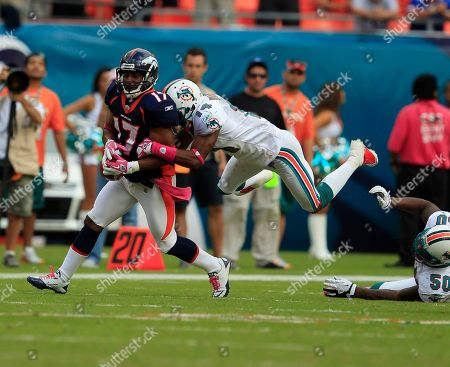 Quan Cosby, Marlon Moore Denver Broncos wide receiver Quan Cosby (17) is tackled by Miami Dolphins wide receiver Marlon Moore during the second half of an NFL football game, in Miami