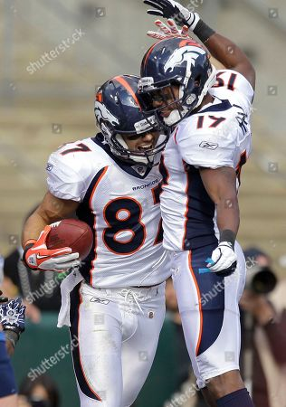 Eric Decker, Quan Cosby Denver Broncos wide receiver Eric Decker (87) celebrates with wide receiver Quan Cosby after scoring on a 27-yard touchdown pass from quarterback Tim Tebow in the first quarter of an NFL football game against the Oakland Raiders in Oakland, Calif