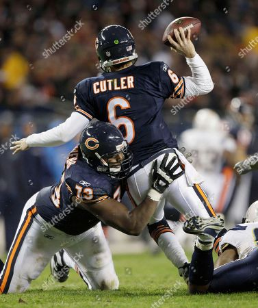 Jay Cutler, Antwan Barnes, J'Marcus Webb Chicago Bears quarterback Jay Cutler (6) tries to get a pass off after getting hit by San Diego Chargers linebacker Antwan Barnes, right, in the second half of an NFL football game in Chicago, . Helping Cutler is teammate J'Marcus Webb (73