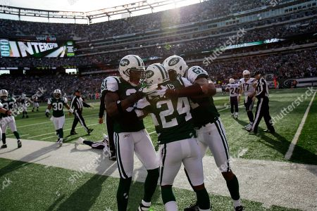 Darelle Revis Teammates surround New York Jets cornerback Darrelle Revis (24) after he interecepted a pass from San Diego Chargers during the fourth quarter of an NFL football game between the San Diego Chargers and the New York Jets, in East Rutherford, N.J