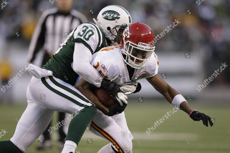 Stock Picture of Steve Breaston, Donald Strickland Kansas City Chiefs' Steve Breaston, right, is tackled by New York Jets' Donald Strickland during the fourth quarter of the NFL football game, in East Rutherford, N.J. The Jets beat the Chiefs 37-10