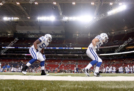 Indianapolis Colts' Kerry Neal, left, and Chris Colasanti warm up before the start of an NFL preseason football game against the St. Louis Rams in St. Louis