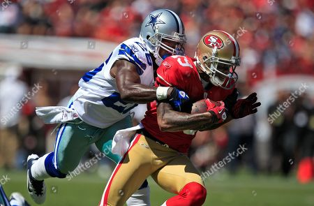 Abram Elam, Ted Ginn Jr San Francisco 49ers' wide receiver Ted Ginn Jr. (19) is tackled by Dallas Cowboys' defensive back Abram Elam (26) in an NFL football game in San Francisco