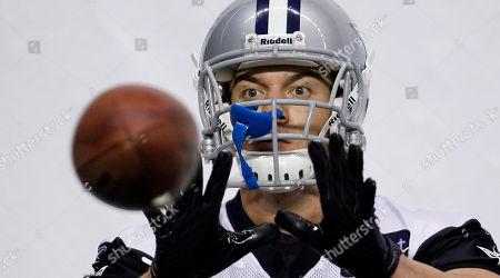 Chris Gronkowski Dallas Cowboys' Chris Gronkowski catches a machine-thrown ball during NFL football practice, in San Antonio