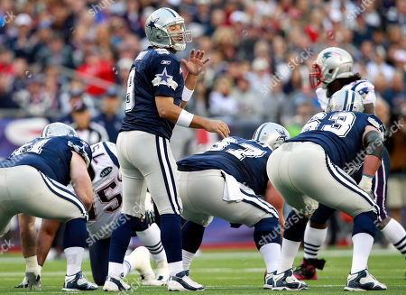 Tony Romo, Bill Nagy, Phil Costa, Kyle Kosier, Vince Wilfork Dallas Cowboys quarterback Tony Romo (9) calls signals from behind guard Bill Nagy (61), center Phil Costa (67) and guard Kyle Kosier (63) against New England Patriots nose tackle Vince Wilfork (75) and others during an NFL football game in Foxborough, Mass