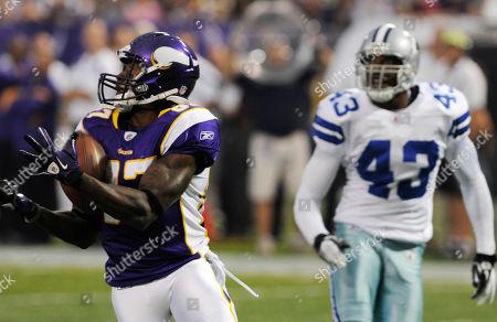 Bernard Berrian, Gerald Sensabaugh Minnesota Vikings wide receiver Bernard Berrian catches a touchdown pass in front of Dallas Cowboys safety Gerald Sensabaugh (43) during the first quarter of an NFL preseason football game, in Minneapolis