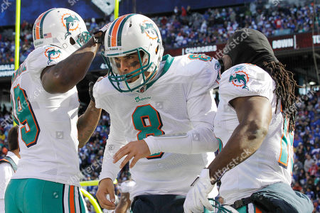 Matt Moore, Brandon Marshall, Nate Garner Miami Dolphins quarterback Matt Moore (8) is congratulated on his touchdown by teammates Brandon Marshall, left, and Nate Garner during the second quarter of an NFL football game, in East Rutherford, N.J