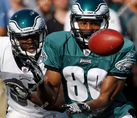 Stock Photo of Brandon Caleb, Jamar Wall Philadelphia Eagles wide receiver Brandon Caleb, right, catches the ball as he is defended by defensive back Jamar Wall during an NFL football training camp practice at Lehigh University in Bethlehem, Pa