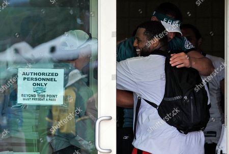 Mike Patterson, Todd Herremans Philadelphia Eagles defensive tackle Mike Patterson, back to camera, hugs teammate Todd Herremans as he enters the locker room at the teams NFL football training camp at Lehigh University in Bethlehem, Pa. Patterson was released from the hospital after suffering a seizure Wednesday at practice