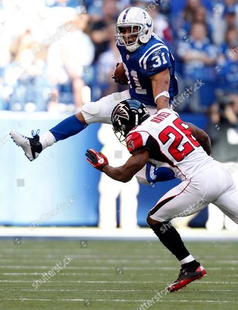 Donald Brown, Kelvin Hayden Indianapolis Colts' Donald Brown is tackled by Atlanta Falcons' Kelvin Hayden during the first half of an NFL football game, in Indianapolis