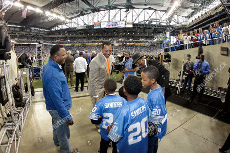 Barry Sanders, Charlie Sanders, Lem Barney Former Detroit Lions players Barry Sanders, left, Charlie Sanders, center, and Lem Barney meet with children before the first quarter of an NFL football game against the Atlanta Falcons in Detroit, . AP Photo/Carlos Osorio