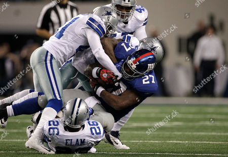 Terence Newman, Abram Elam, Brandon Jacobs New York Giants running back Brandon Jacobs (27) is tackled by Dallas Cowboys' strong safety Abram Elam (26), cornerback Terence Newman (41) and others during an NFL football game, in Arlington, Texas. The Giants won 37-34