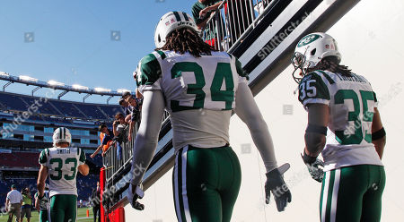Marquice Cole, Isaiah Trufant New York Jets defensive back Marquice Cole (34) and defensive back Isaiah Trufant (35) head onto the field for warm ups prior to facing the New England Patriots in an NFL football game in Foxborough, Mass