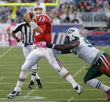 Tom Brady, Muhammad Wilkerson New England Patriots quarterback Tom Brady (12) tries to get away from New York Jets defensive end Muhammad Wilkerson (96) as he looks for an open receiver during the third quarter of an NFL football game in Foxborough, Mass