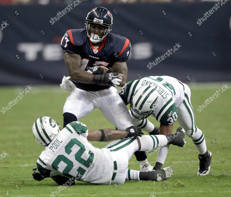 Houston Texans fullback Lawrence Vickers (47) is hit by New York Jets safety Brodney Pool (22) and cornerback Donald Strickland (30) during the third quarter of an NFL preseason football game, in Houston