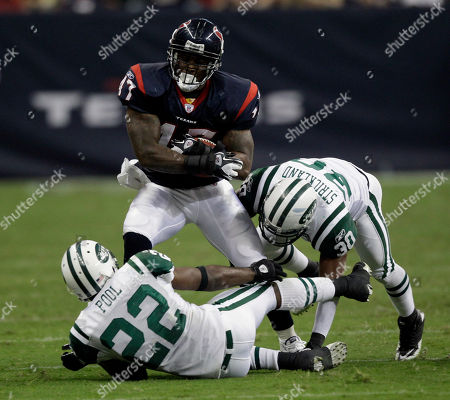 Houston Texans fullback Lawrence Vickers (47) is tackled by New York Jets safety Brodney Pool (22) and cornerback Donald Strickland (30) during the third quarter of an NFL preseason football game, in Houston