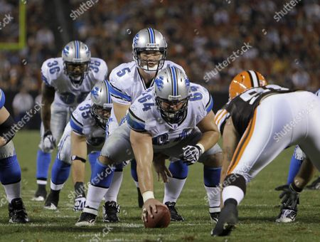 Stock Image of Drew Stanton, Dan Gerberry Detroit Lions quarterback Drew Stanton (5) waits for the snap from center Dan Gerberry (64) during a preseason NFL football game against the Cleveland Browns, in Cleveland