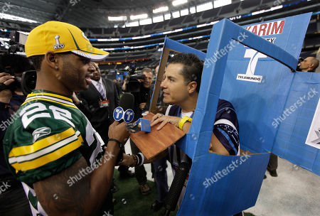 Green Bay Packers' Pat Lee answers a question from reporter Karim Mendiburu during media day for NFL football Super Bowl XLV, in Arlington, Texas