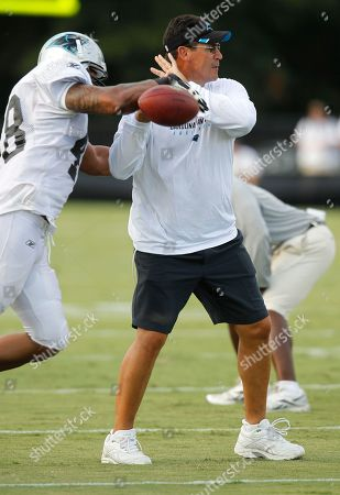 Ron Rivera, Kelvin Smith Carolina Panthers head coach Ron Rivera, right, helps Kelvin Smith (48) with a drill at the NFL football team's training camp in Spartanburg, S.C