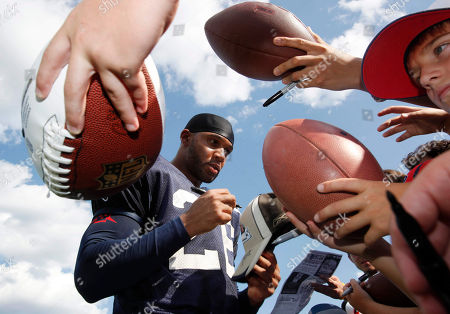 Bret Lockett New England Patriots defensive back Bret Lockett signs autographs during an NFL football training camp in Foxborough, Mass