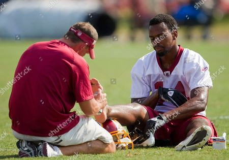 Malcolm Kelly Washington Redskins wide receiver Malcolm Kelly has his foot looked at by a trainer during the NFL football team's training camp practice, in in Ashburn, Va