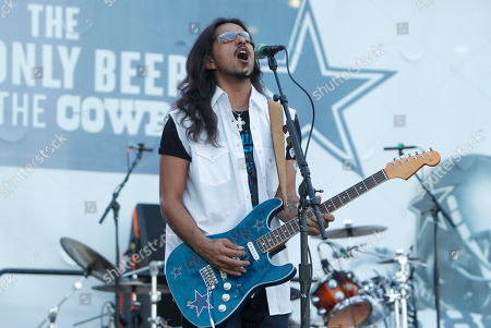 Los Lonely Boys guitarist Henry Garza performs before an NFL football game, in Arlington, Texas
