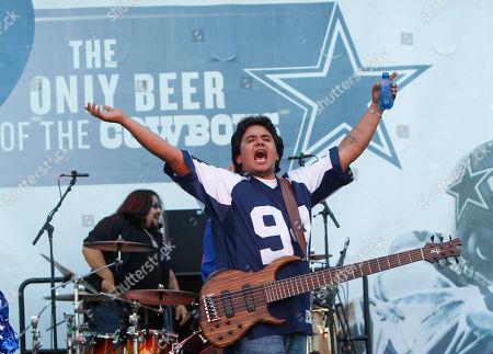 Jojo Garza Los Lonely Boys bassist Jojo Garza performs before an NFL football game, in Arlington, Texas