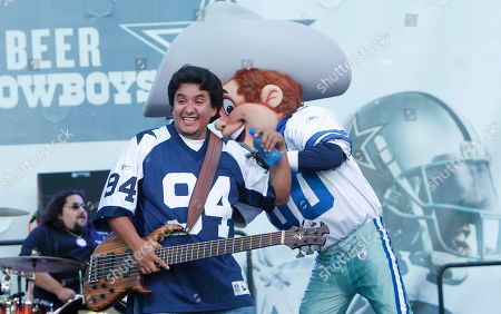Stock Picture of Jojo Garza Los Lonely Boys bassist Jojo Garza plays around with the Dallas Cowboys mascot before an NFL football game, in Arlington, Texas