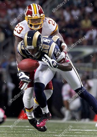 DeAngelo Hall, Mike Sims-Walker St. Louis Rams wide receiver Mike Sims-Walker (10) drops a pass as Washington Redskins cornerback DeAngelo Hall (23) defends during the first quarter of the NFL football game, in St. Louis