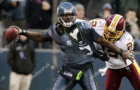 Tarvaris Jackson, Kevin Barnes Seattle Seahawks quarterback Tarvaris Jackson, left, is pressured by Washington Redskins' Kevin Barnes late in the second half of an NFL football game, in Seattle. The Redskins won 23-17