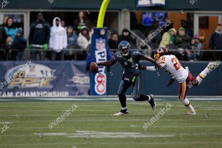 Tarvaris Jackson, Kevin Barnes Seattle Seahawks quarterback Tarvaris Jackson, left, is pressured by Washington Redskins' Kevin Barnes in the second half of an NFL football game, in Seattle
