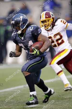 Marshawn Lynch, Kevin Barnes Seattle Seahawks Marshawn Lynch, right, runs under pressure from Washington Redskins Kevin Barnes in the second half of an NFL football game, in Seattle