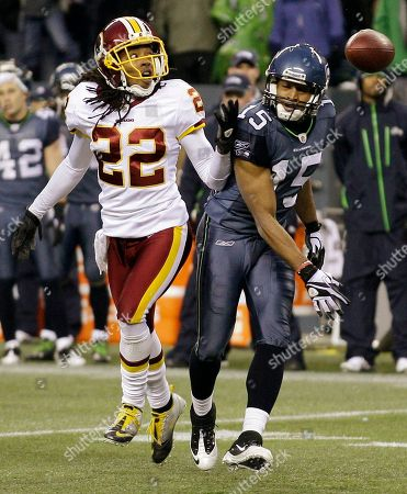 Doug Baldwin, Kevin Barnes Washington Redskins' Kevin Barnes (22) breaks up a pass intended for Seattle Seahawks' Doug Baldwin (15) in the second half of an NFL football game, in Seattle. The Redskins won 23-17