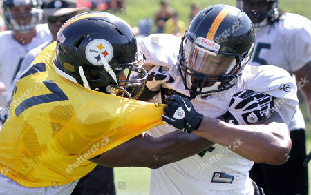 Brake Atkins, Weslye Saunders Pittsburgh Steelers linebacker Brake Atkins, left, and running back Weslye Saunders battle in drills during training camp at the NFL football team's practice facility in Latrobe, Pa. on