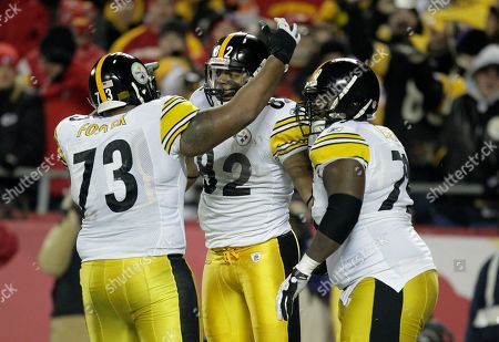 Weslye Saunders, Ramon Foster, Trai Essex Pittsburgh Steelers tight end Weslye Saunders (82) celebrates with offensive guard Ramon Foster (73) and tackle Trai Essex, left, after scoring a touchdown during the first half of an NFL football game against the Kansas City Chiefs, in Kansas City, Mo