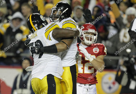 Trai Essex, Weslye Saunders, Sabby Piscitelli Pittsburgh Steelers tight end Weslye Saunders (82) celebrates a touchdown with teammate Trai Essex (79) during the first half of an NFL football game against the Kansas City Chiefs at Arrowhead Stadium in Kansas City, Mo., . Kansas City Chiefs defensive back Sabby Piscitelli (42) tries to stay out of the celebration