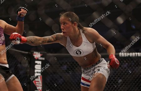 Germaine de Randamie Germaine de Randamie fights Stephanie Webber during a Strikeforce mixed martial arts fight in San Jose Calif