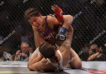 Stephanie Webber, Germaine de Randamie Stephanie Webber, top, fights Germaine de Randamie during a Strikeforce mixed martial arts fight in San Jose Calif