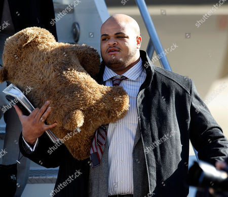 New York Giants tackle James Brewer is seen as the team arrives at the Indianapolis International Airport for NFL footbal's Super Bowl XLVI, in Indianapolis