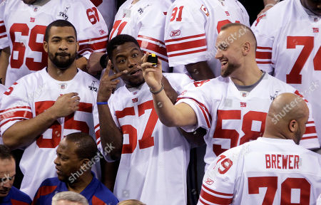 New York Giants linebacker Spencer Paysinger (55), Jacquian Williams (57) and Mark Herzlich (58) have some fun during Media Day for NFL football's Super Bowl XLVI, in Indianapolis