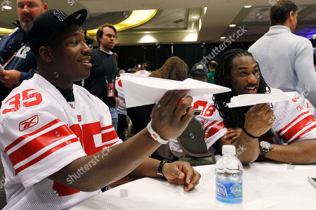 Andre Brown, Isaiah Stanback New York Giants practice squad players Andre Brown, left, and Isaiah Stanback, right, make paper airplanes during a media availability, in Indianapolis. The Giants will face the New England Patriots in the NFL football Super Bowl XLVI on Feb. 5