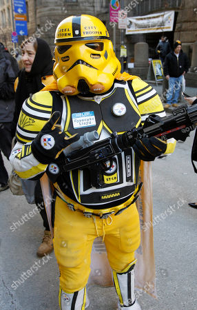 """Scott Mason Scott Mason carries a toy blaster while wearing his """"Steel City Storm Trooper"""" costume at a Pittsburgh Steelers pep rally, in Pittsburgh. Mason won a contest for the best costume. The Steelers face the Green Bay Packers in NFL football's Super Bowl XLV on Sunday, in Arlington, Texas"""